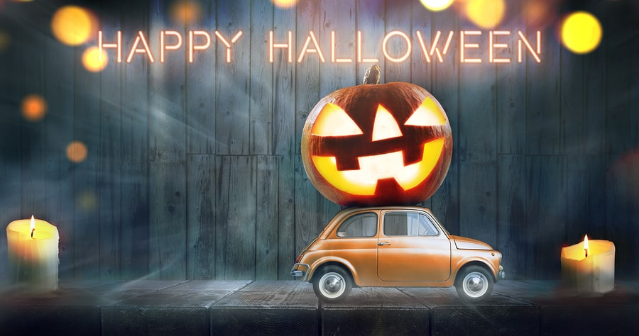 car delivering a scary pumpkin