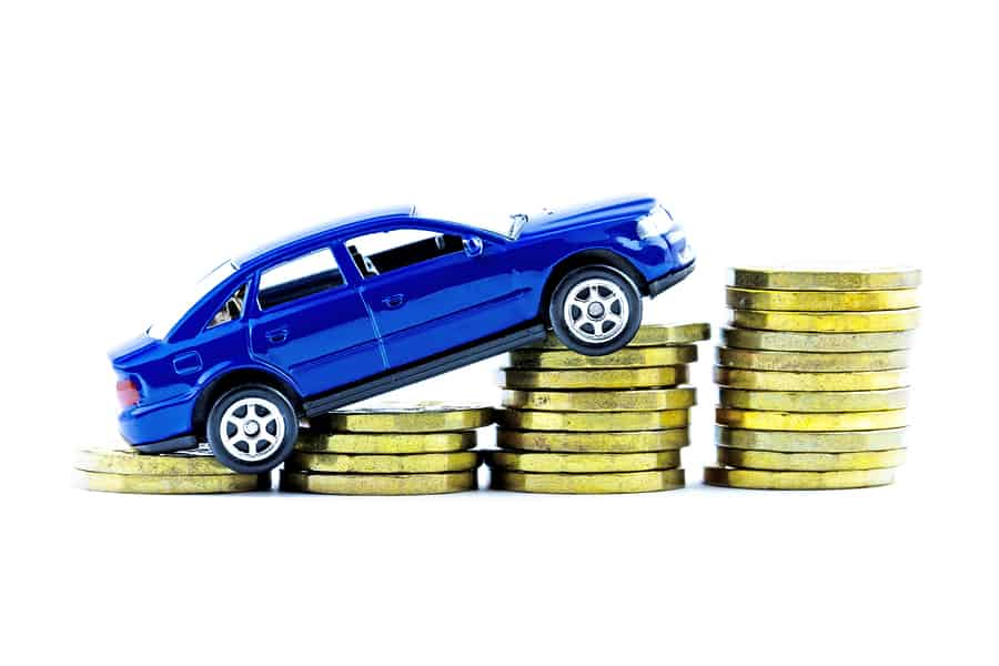 blue model car on piles of coins