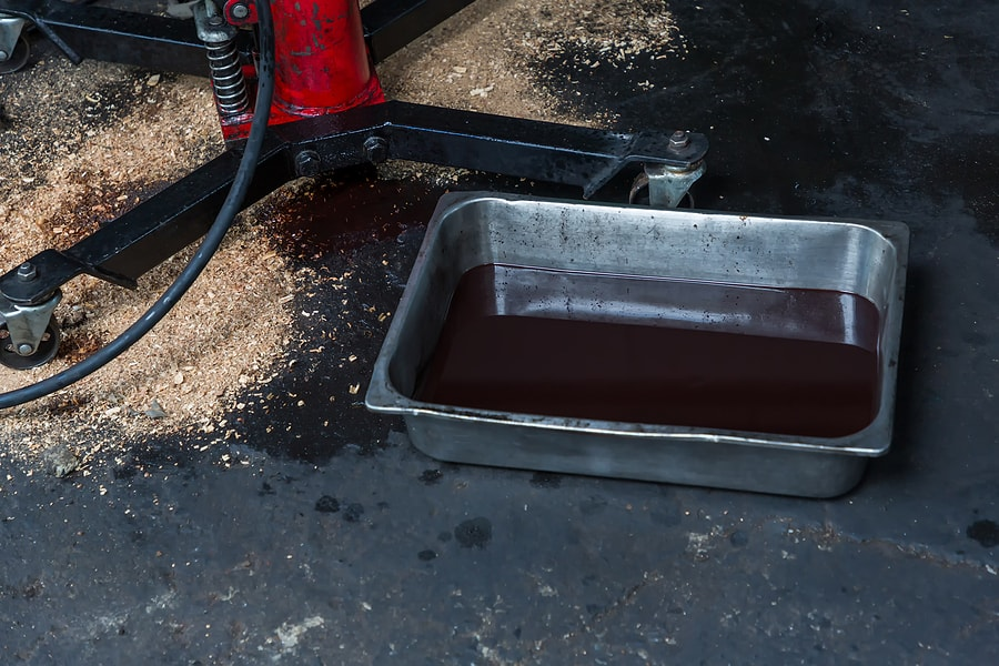 car waste oil in a tray